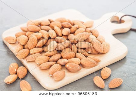 Almond Nuts On Wooden Plate
