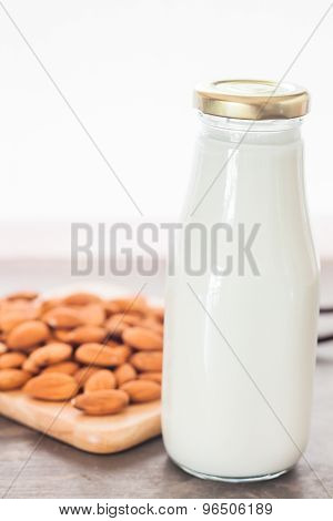 Almond Nuts On Wooden Plate With Milk