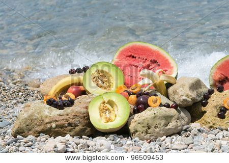 Summer fruits against the waves.