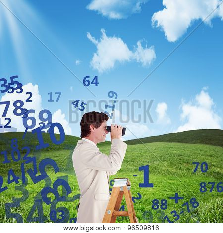 Businessman looking on a ladder against blue sky over green field