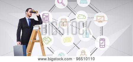 Businessman looking on a ladder against abstract grey room