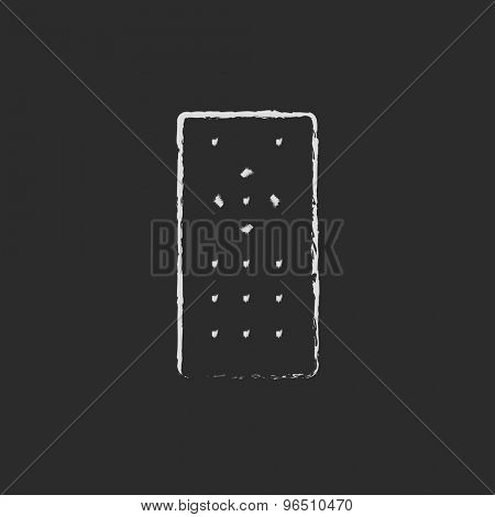 Remote control hand drawn in chalk on a blackboard vector white icon on a black background