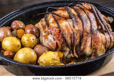 Bacon wrapped roasted chicken stuffed with butternut squash and herbs