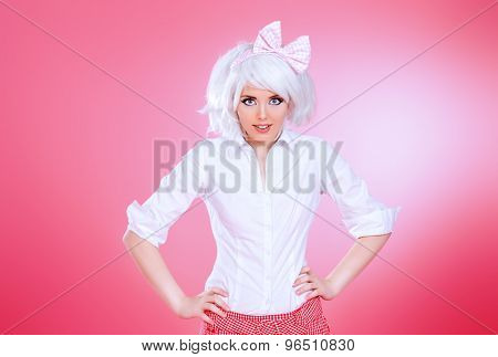 Lovely teen girl wearing white wig and school uniform posing over pink background. Anime style.