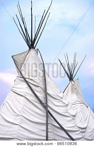 Detail of Teepee or wigwam topsagainst blue sky