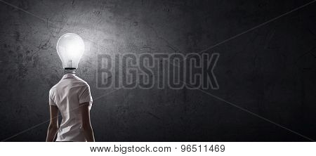 Idea concept with businesswoman and light bulb instead of his head