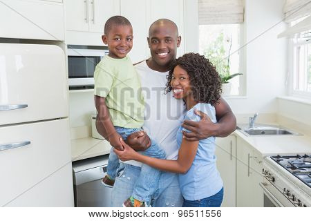 Portrait of a happy smiling happy family in the kitchen
