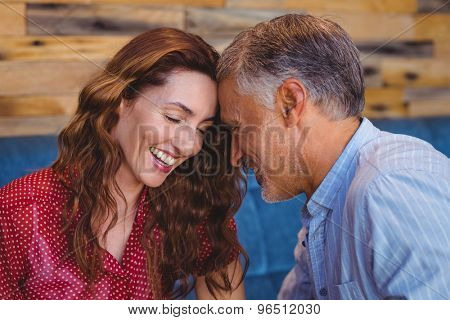 Close up of a couple flirting in a cafe