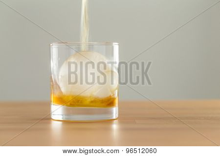 Pouring whiskey in glass