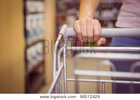 Hand of woman putting on trolley in office