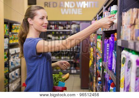 Pretty woman looking at product in supermarket