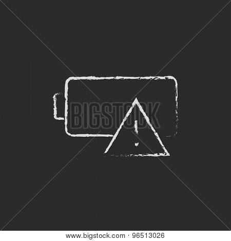 Empty battery  hand drawn in chalk on a blackboard vector white icon on a black background