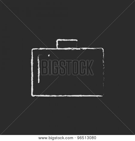 Briefcase hand drawn in chalk on a blackboard vector white icon on a black background