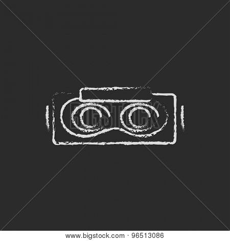 Virtual reality mask hand drawn in chalk on a blackboard vector white icon on a black background