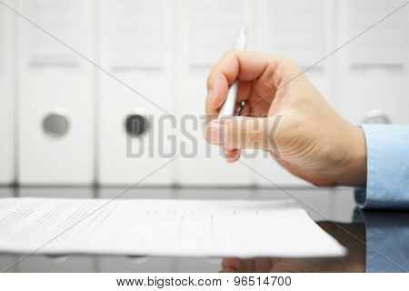Businessman Is Thinking About Articles On Contract Before Signing With Binders In Background