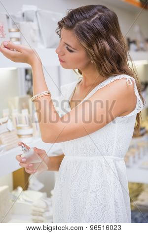 Woman testing perfume at a beauty salon