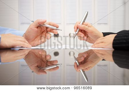Man And Woman Discussing On Business Meeting About Document
