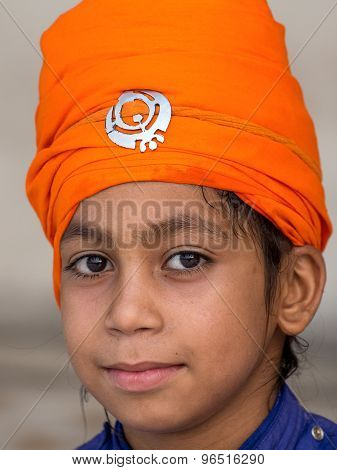 Young Sikh Boy Visiting The Golden Temple In Amritsar, Punjab, India.