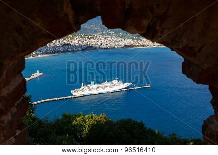 Cruise Ship Through Hole Of Old Castle In Alanya