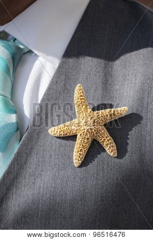 starfish boutonniere on suit for beach wedding