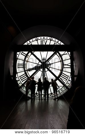Paris, France - May 14, 2015: Silhouettes Of Unidentified Tourists Looking Through The Clock With Ro
