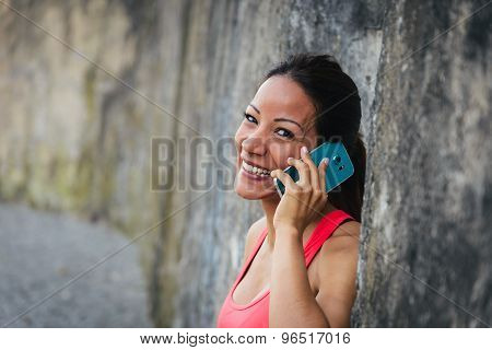 Happy Sporty Woman With Smartphone