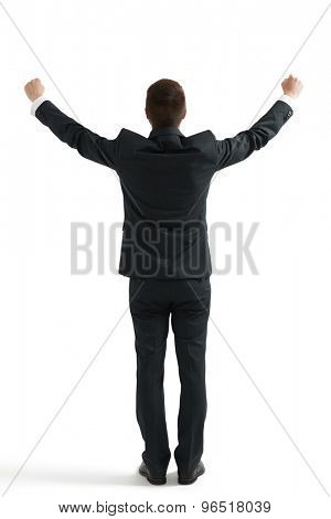back view of happy businessman in formal wear with raising hands up. isolated on white background