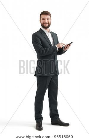 full length portrait of smiley businessman with smartphone looking at camera. isolated on white background