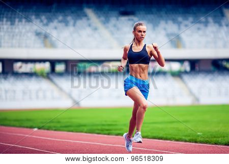 Fitness woman on stadium running