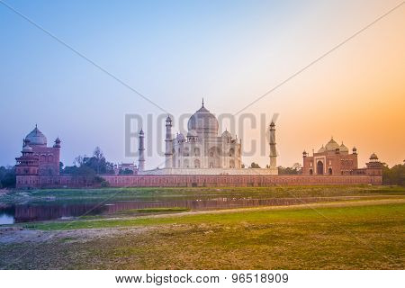 Taj Mahal from northern side across the Yamuna river at sunset.