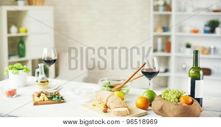 Fresh fruit, vegs, groceries and wine on the table