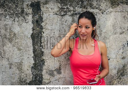 Sporty Woman With Earphones And Smartphone