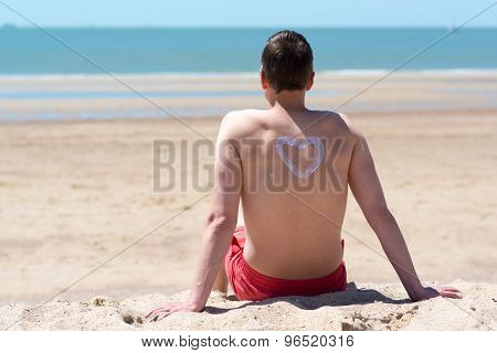man on the beach watching at the ocean