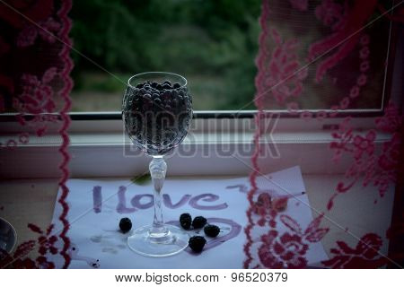 glass of blueberry, romance on the window