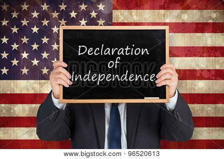 Businessman showing board against usa flag in grunge effect