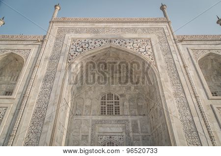 Close up detailed view of South side of Taj Mahal. Post-processed with grain, texture and colour effect.