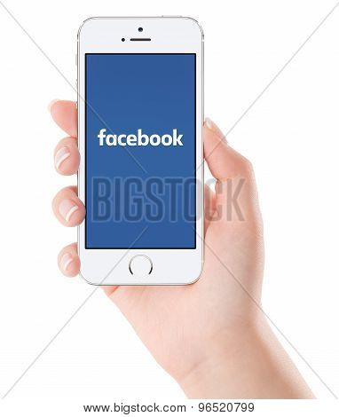 Facebook Logo On The White Apple Iphone 5S Display In Female Hand