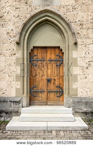 Brown church door with gothic stepped portal