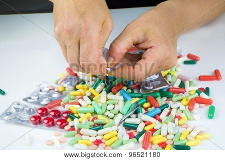 Hands Holding A Lot Of Pills