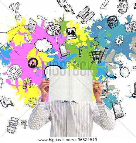 Businessman holding a white card covering his face against technology and business icons on paint splashes