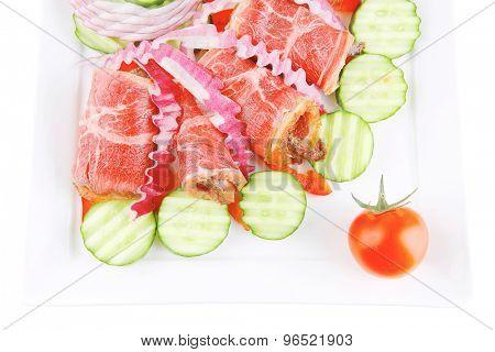 roast beef meat rolls on white platter