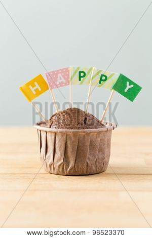 Flag on muffin with a word happy