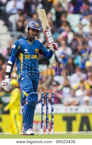 LONDON, ENGLAND - June 17 2013: Sri Lanka's Lahiru Thirimanne celebrates 50 runs during the ICC Champions Trophy international cricket match between Sri Lanka and Australia.