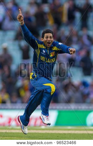 LONDON, ENGLAND - June 17 2013: Sri Lanka's Tillakaratne Dilshan celebrates taking the wicket of Clint McKay to win the match during the ICC Champions Trophy between Sri Lanka and Australia.