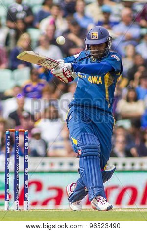 LONDON, ENGLAND - June 17 2013: Sri Lanka's Lahiru Thirimanne hits the ball during the ICC Champions Trophy international cricket match between Sri Lanka and Australia.