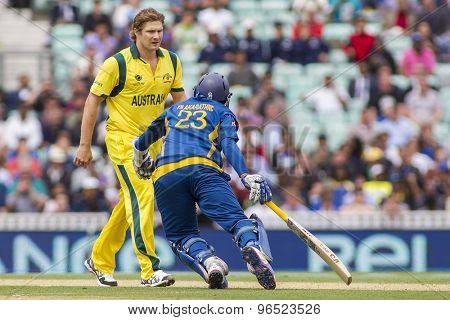 LONDON, ENGLAND - June 17 2013:  Australia's Shane Watson and Sri Lanka's Tillakaratne Dilshan during the ICC Champions Trophy international cricket match between Sri Lanka and Australia.