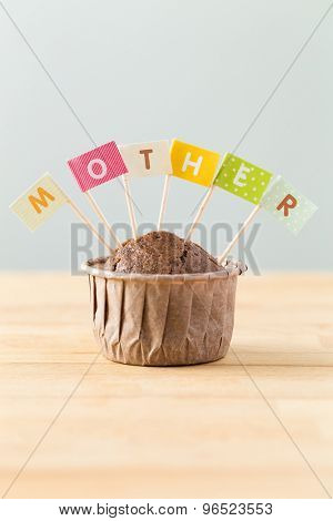 Flag on muffin with a word mother