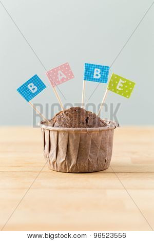 Flag on muffin with a word babe