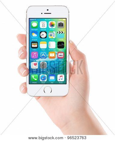 Ios 9 Homescreen On The White Apple Iphone 5S Display In Female Hand