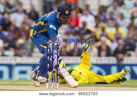 LONDON, ENGLAND - June 17 2013: Sri Lanka's Kumar Sangakkara runs a single during the ICC Champions Trophy international cricket match between Sri Lanka and Australia.